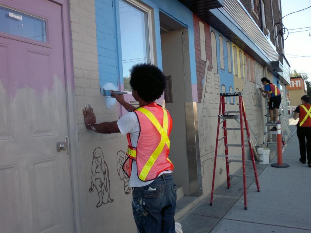 Painting mural - Greenwood: Bricks and Wagons