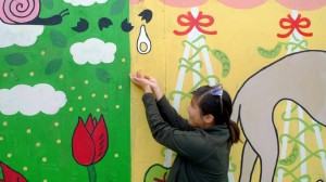 Melissa Luk, CONTINUUM participant, led a volunteer mural at Sorauren Farmers Market with her newly-founded arts collective Buck Teeth Girls Club